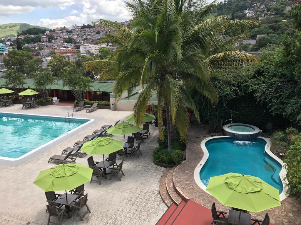 The swimming pool at or near Hotel Honduras Maya