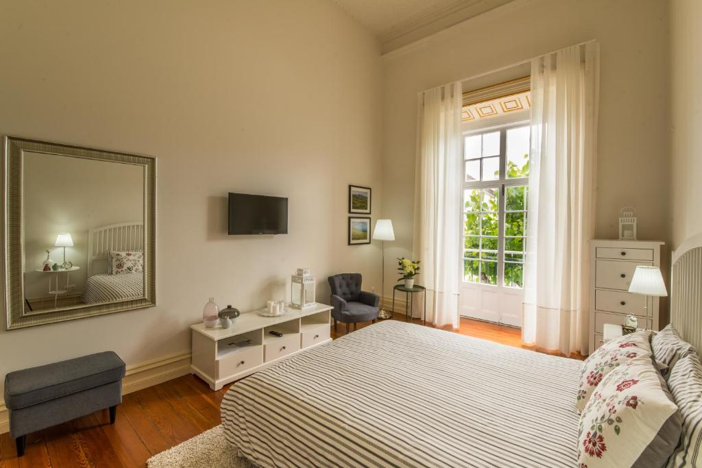 A bed or beds in a room at Casa Ateneu