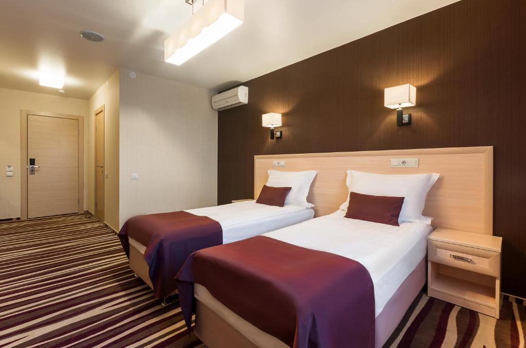 Кровать или кровати в номере Отель Дегас Лайт
