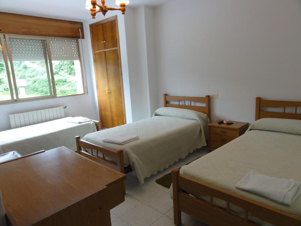 Tempat tidur dalam kamar di Pensión Monterredondo