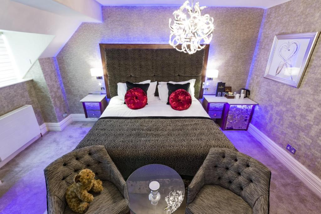 A bed or beds in a room at The Cranleigh Boutique