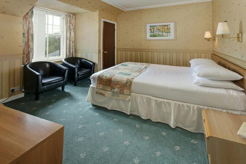 Gulta vai gultas numurā naktsmītnē St Michaels Inn
