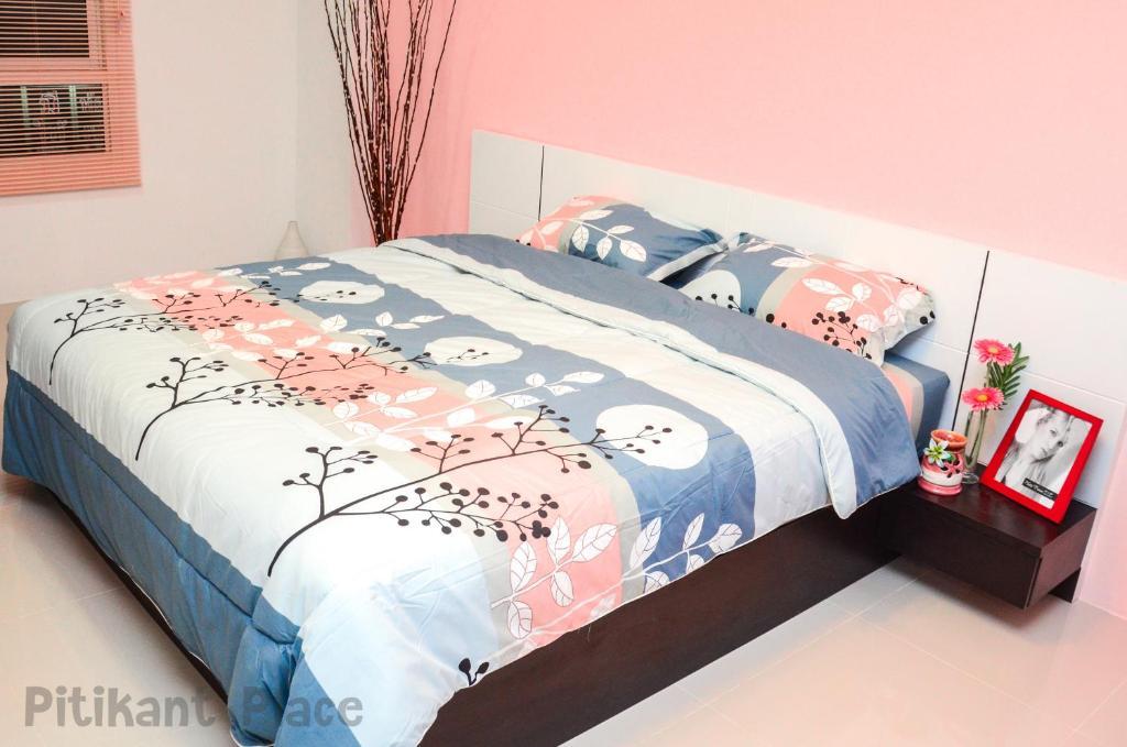 피티칸트 플레이스 객실 침대