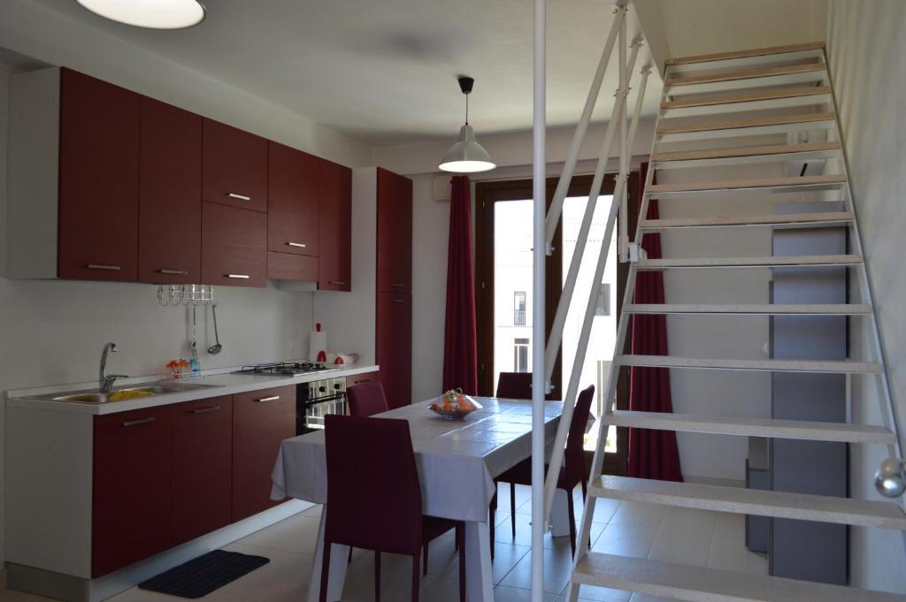 Cucina o angolo cottura di Borgo Vigata Residence