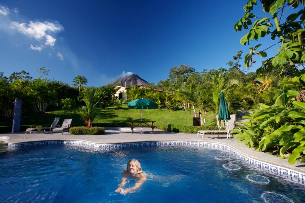 The swimming pool at or near Arenal Volcano Inn