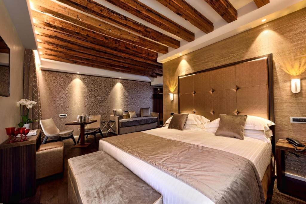Un ou plusieurs lits dans un hébergement de l'établissement Rosa Salva Hotel