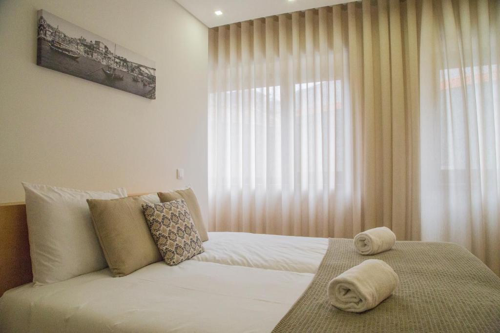 Uma cama ou camas num quarto em Spot Apartments Trindade