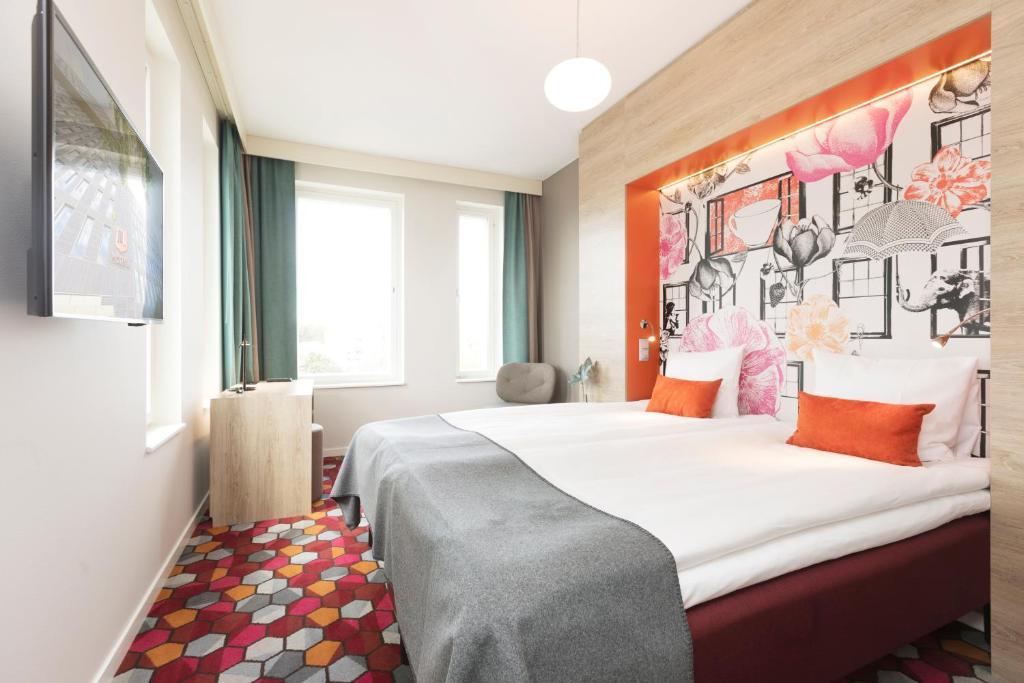 A bed or beds in a room at Motel L Stockholm Älvsjö