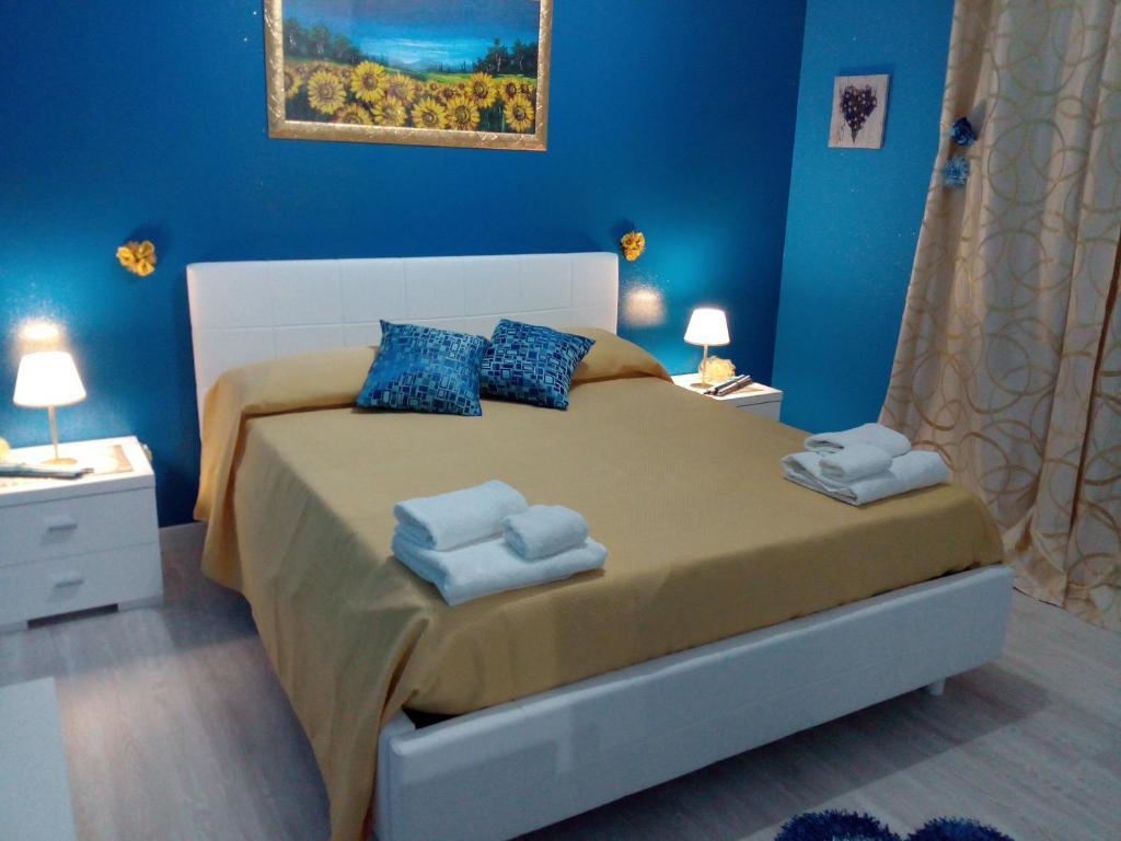 Ein Bett oder Betten in einem Zimmer der Unterkunft Etna En Vie