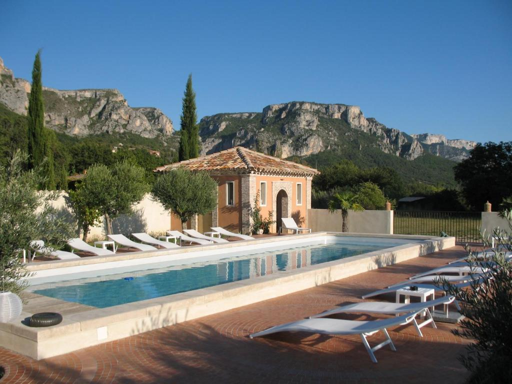 The swimming pool at or near La Ferme Rose-Hôtel de Charme