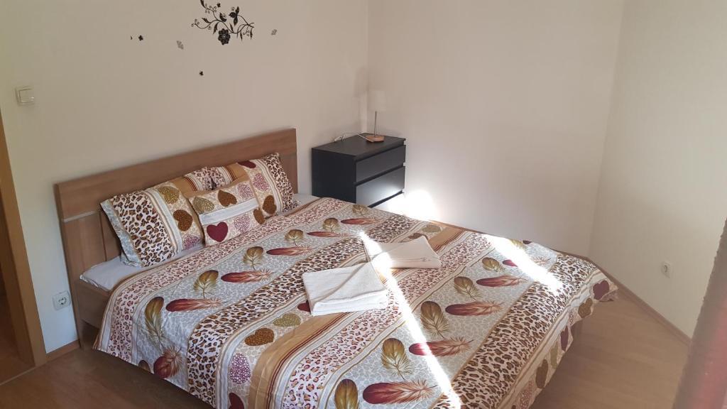Voodi või voodid majutusasutuse Royal Residence toas