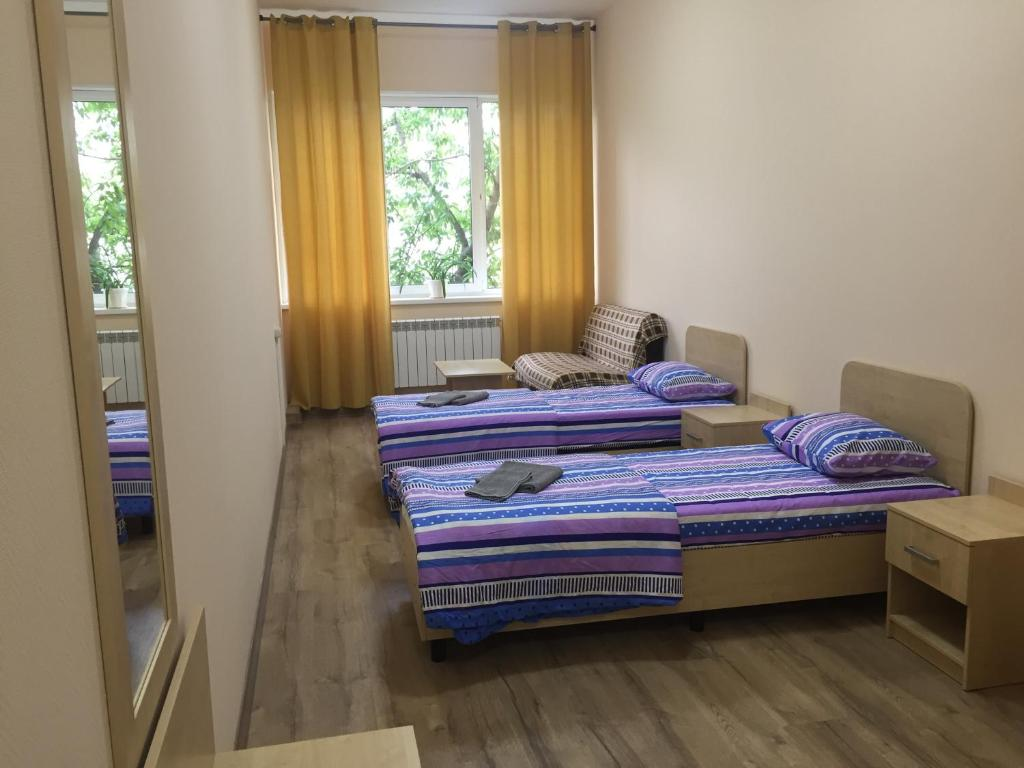 A bed or beds in a room at Hostel TMZ