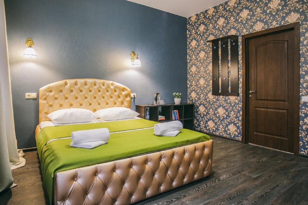 Кровать или кровати в номере Мини-отель Happy Hotel
