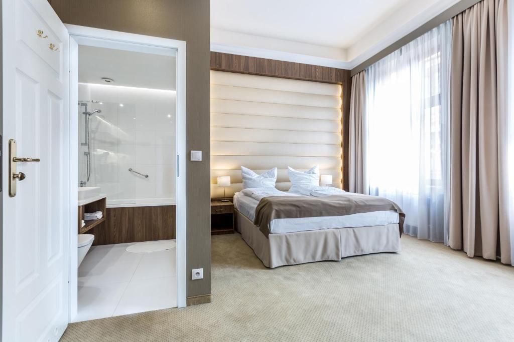 Lova arba lovos apgyvendinimo įstaigoje Hotel Elektor