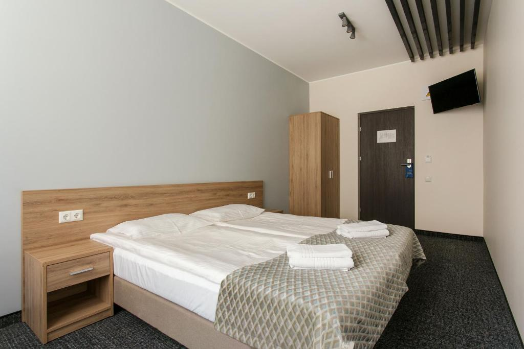 Ein Bett oder Betten in einem Zimmer der Unterkunft Old Town Trio Hostel Rooms