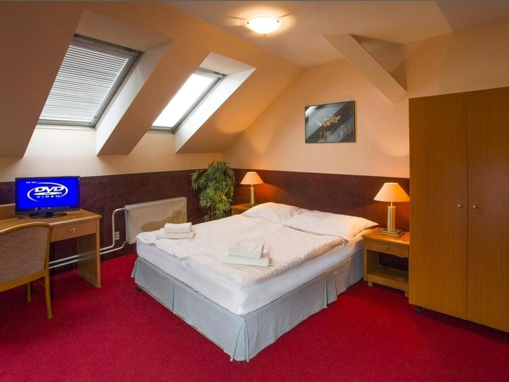 A bed or beds in a room at A Plus Hotel & Hostel