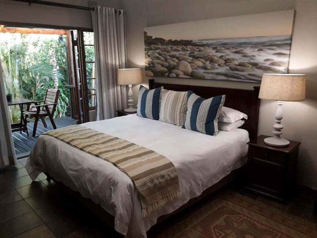 A bed or beds in a room at The Sandpiper