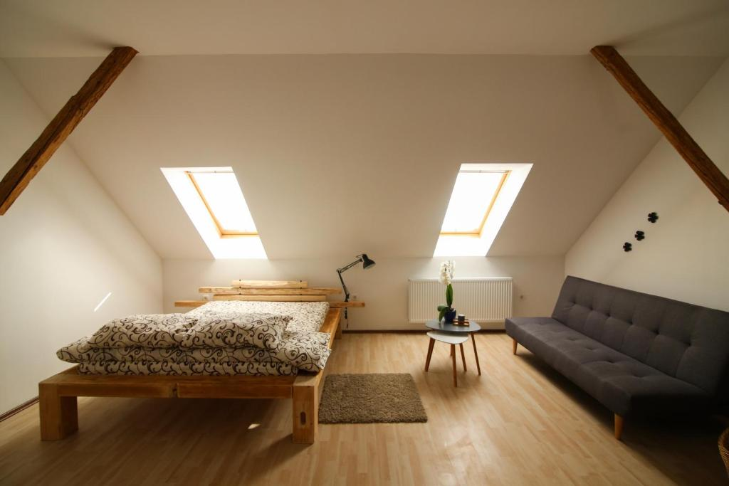 A bed or beds in a room at Rooms Ježek