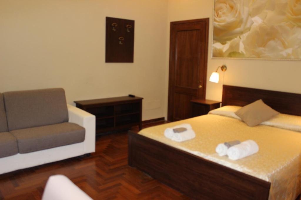 A bed or beds in a room at Ronda St. Angelo Suites