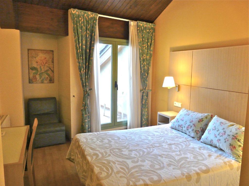 Un ou plusieurs lits dans un hébergement de l'établissement Hotel Nice