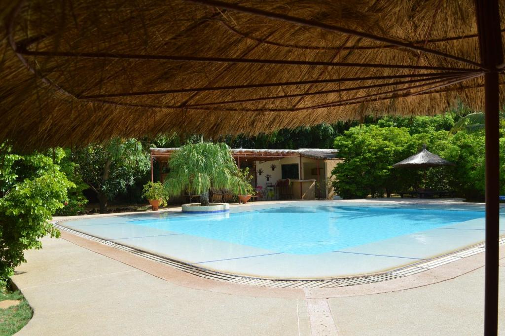 The swimming pool at or near Gîte l'Anacardier