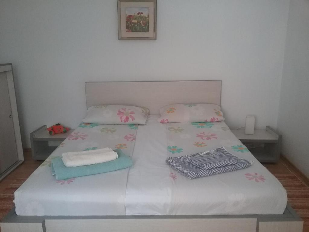 A bed or beds in a room at La Bunica
