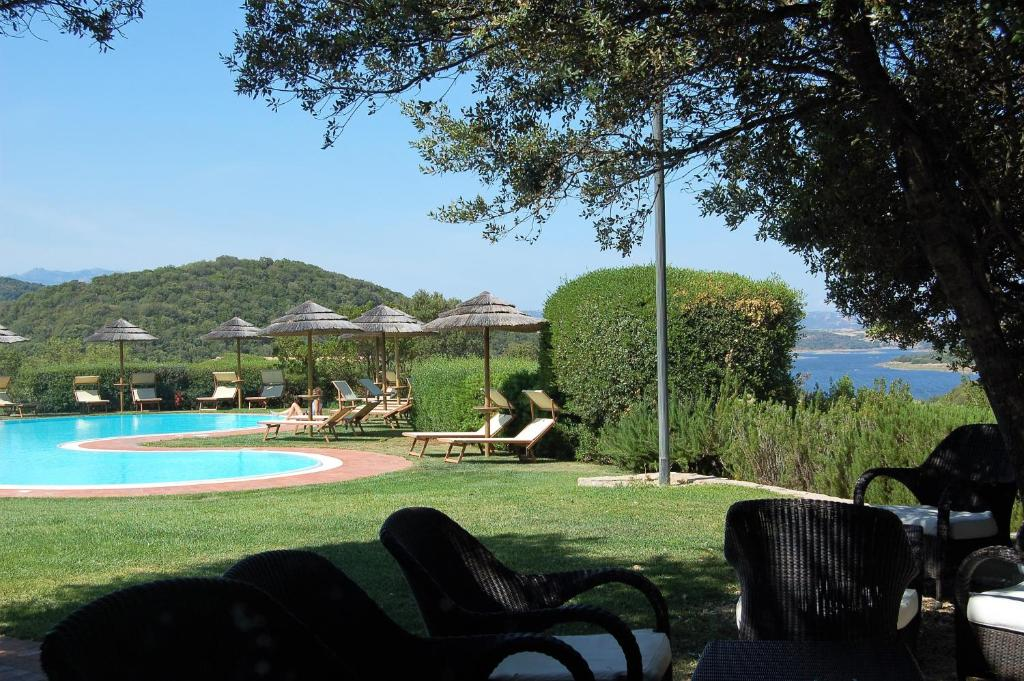 The swimming pool at or near Hôtel Aldiola Country Resort, The Originals Relais (Relais du Silence)