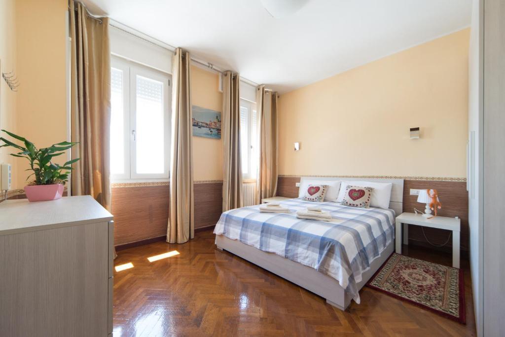 Uma cama ou camas num quarto em Venice Sweet Home Homestay