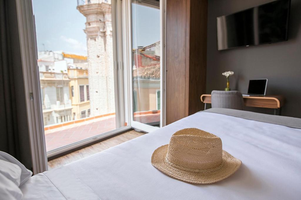 Cama o camas de una habitación en Malaga Premium Hotel