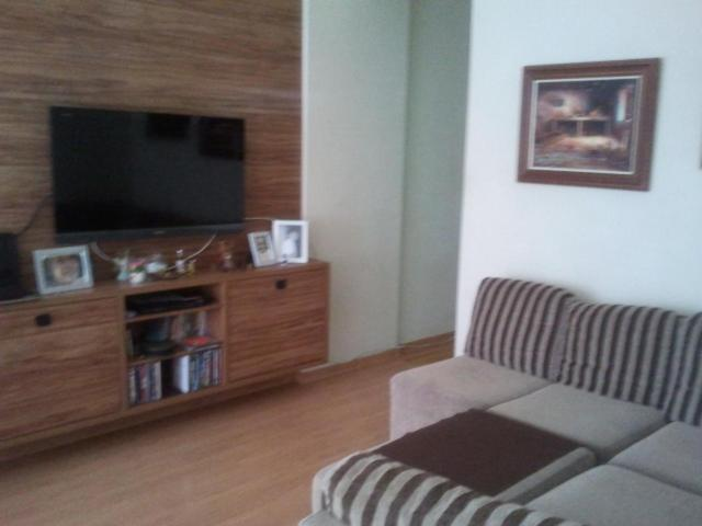 A television and/or entertainment center at Flat ed São Gonçalo