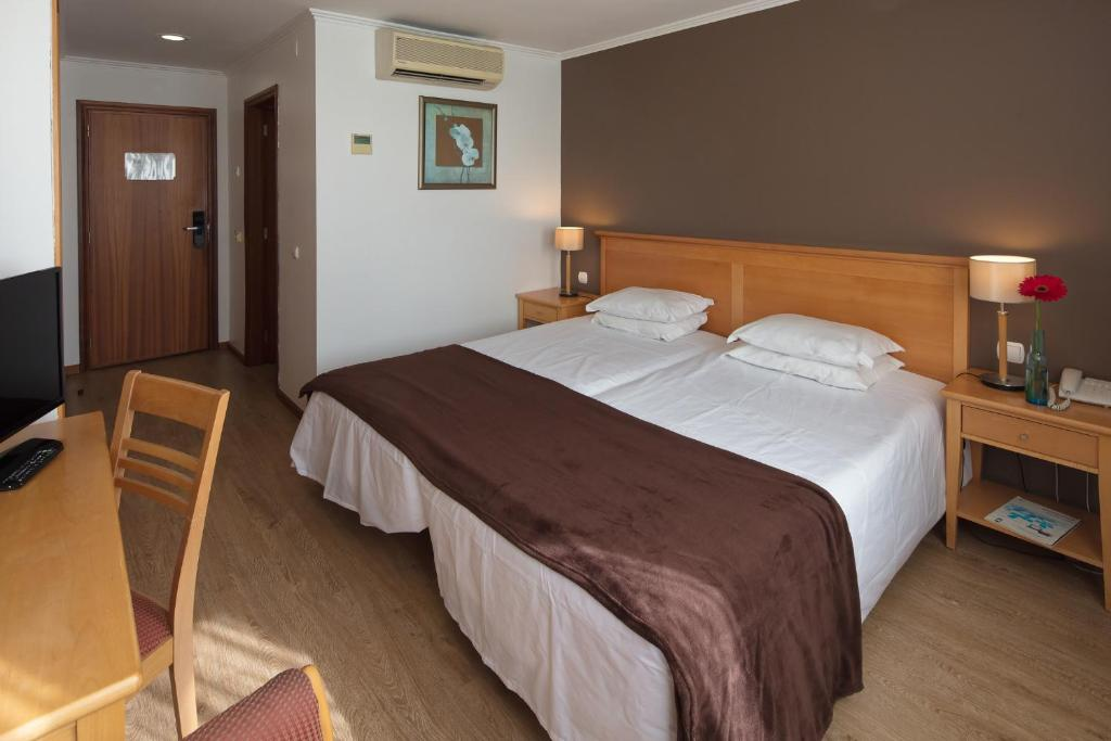 Un ou plusieurs lits dans un hébergement de l'établissement Hotel Orquidea