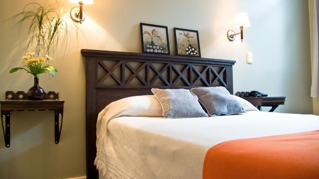 Кровать или кровати в номере Hotel Frossard