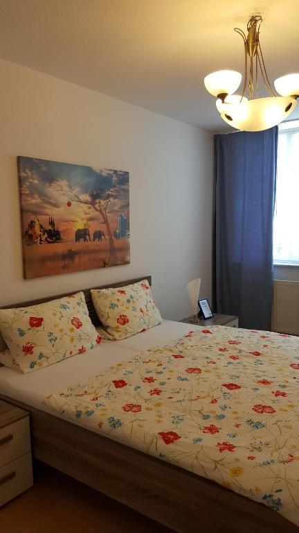Ein Bett oder Betten in einem Zimmer der Unterkunft Altstadtapartment an der Krämerbrücke