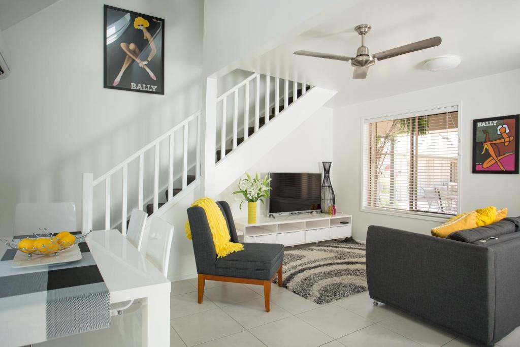 Zona de estar de Byron Central Apartments