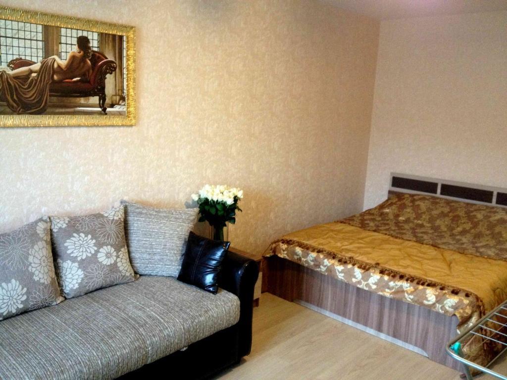 Кровать или кровати в номере КВАРТИРА ЛАДОЖСКАЯ 126