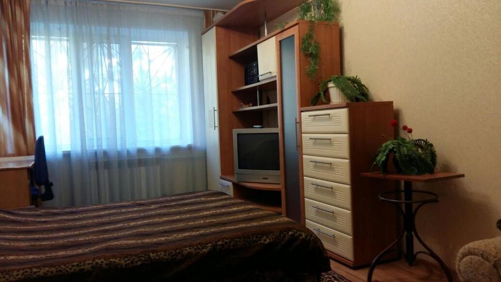 Een bed of bedden in een kamer bij Apartment on Lebedeva