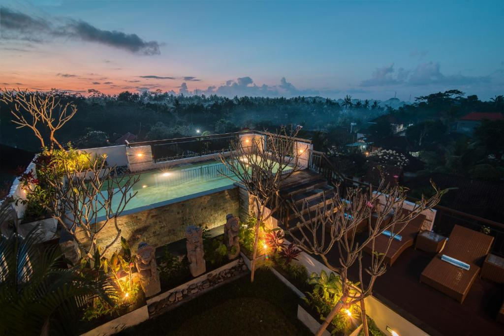 A view of the pool at Pecatu Ubud Guest House or nearby