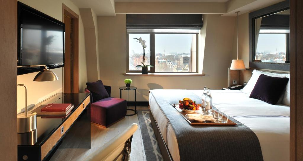 A bed or beds in a room at The Hari London