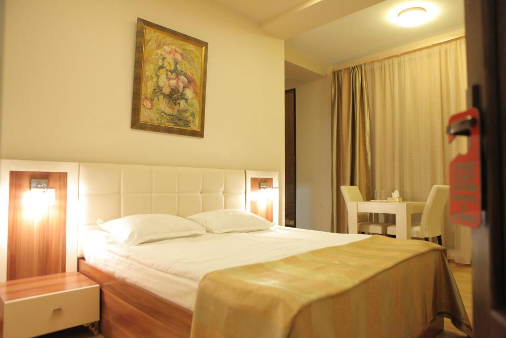 A bed or beds in a room at Daniel Boutique Hotel