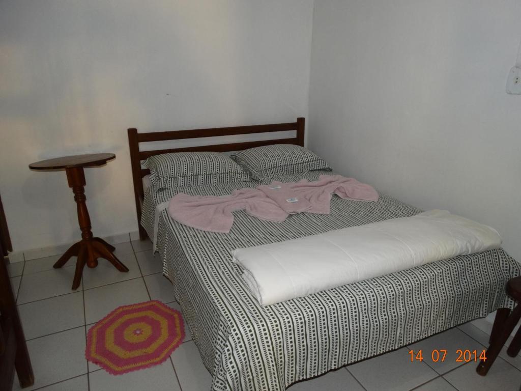 Cama ou camas em um quarto em Pousada Sao Mateus