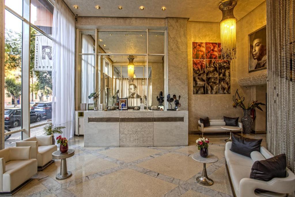 The lobby or reception area at La Renaissance Hotel