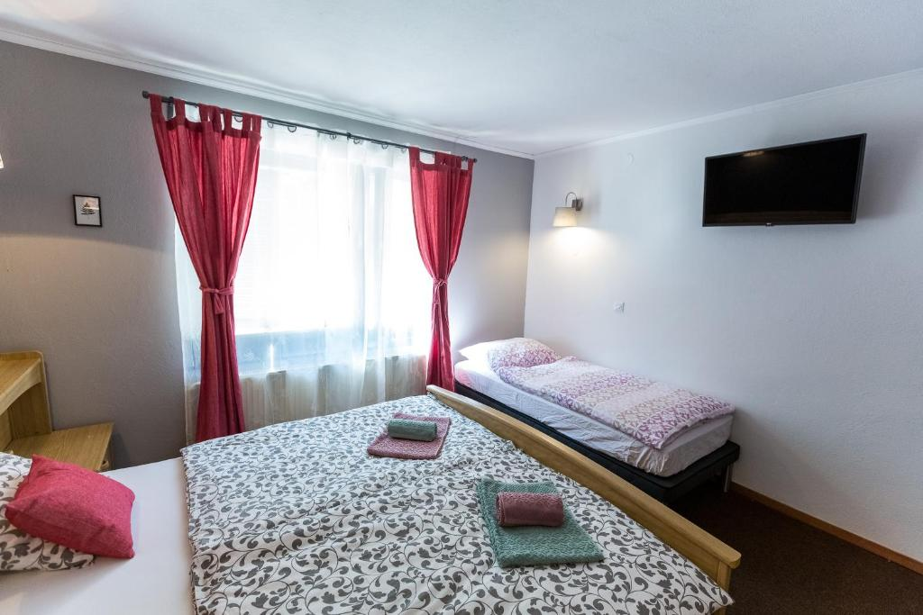 Postelja oz. postelje v sobi nastanitve Rooms Malina