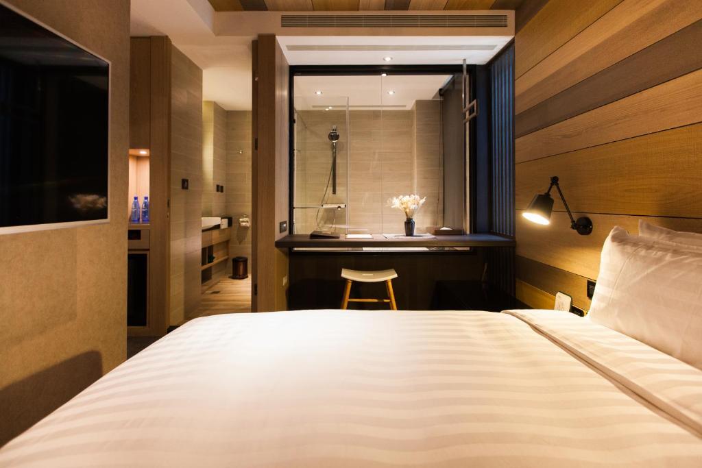 เตียงในห้องที่ Hotel East Taipei