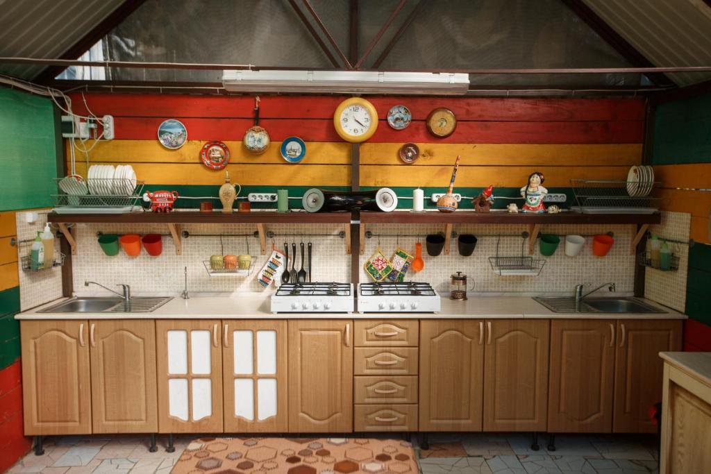 A kitchen or kitchenette at Letnyaya Dacha