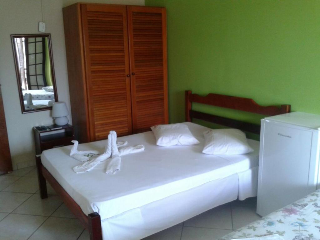 A bed or beds in a room at Pousada Alentejano II