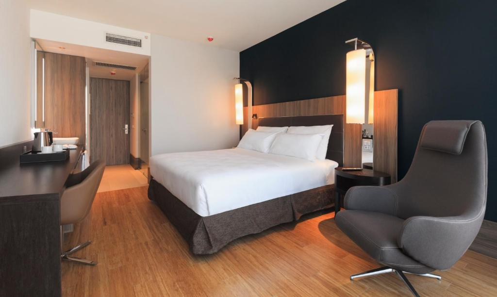 Cama ou camas em um quarto em Studio Icon