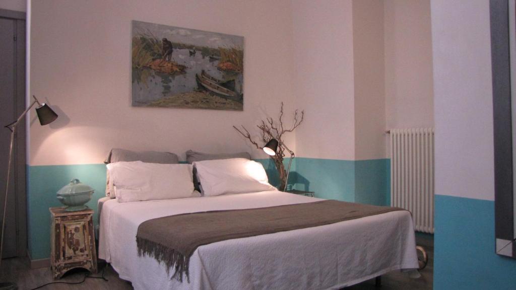Un ou plusieurs lits dans un hébergement de l'établissement Trastevere Colors