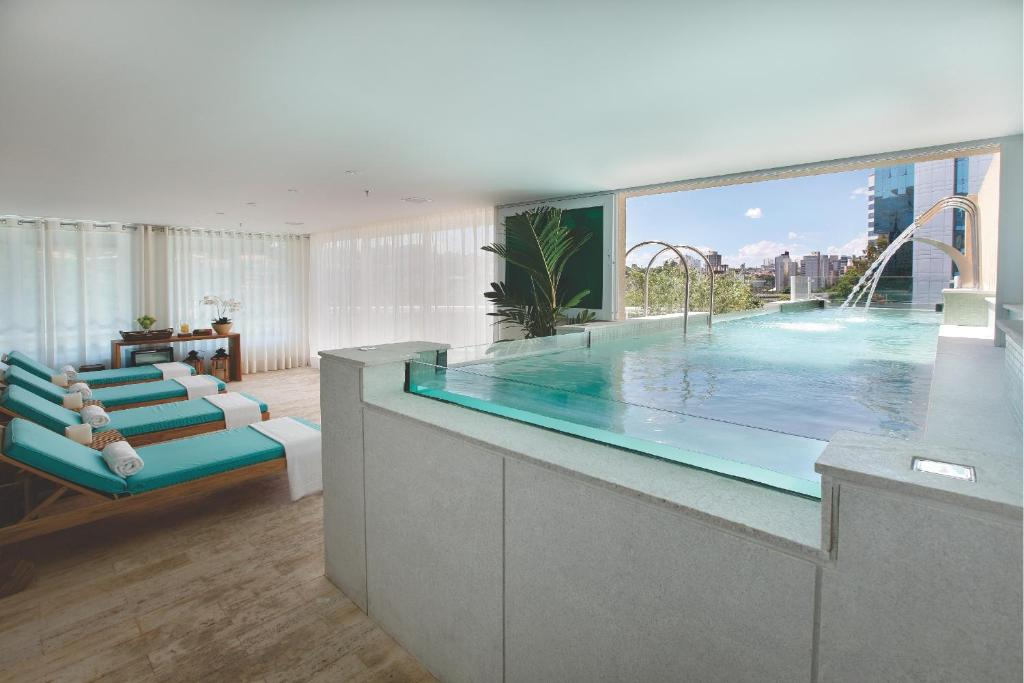 The swimming pool at or near Vitoria Hotel Concept Campinas