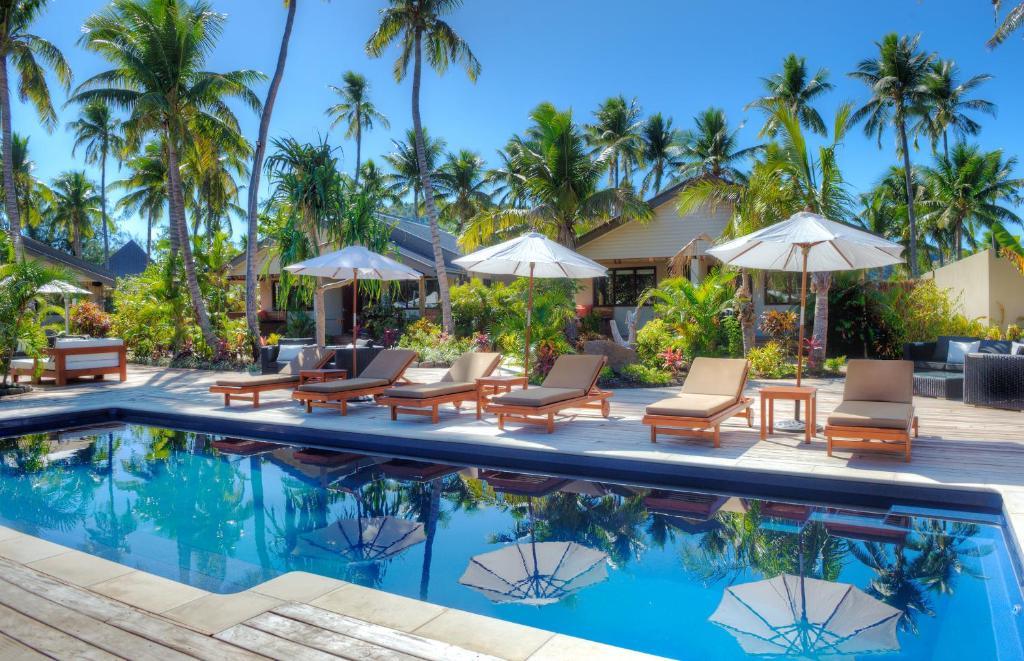 Peldbaseins naktsmītnē Paradise Cove Resort vai tās tuvumā