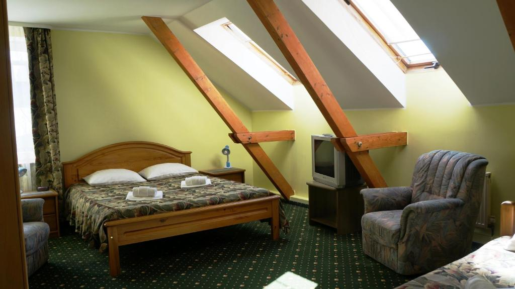 Кровать или кровати в номере Hotel Tukums